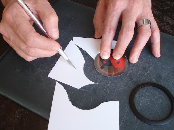 Use clear acrylic lens as a cutting template