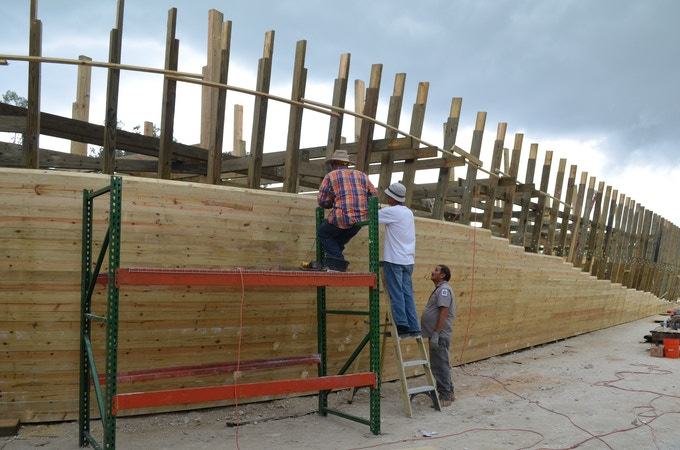 Workers forming the ark walls.