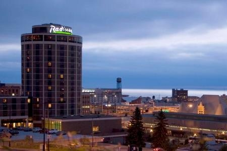 The Radisson. $99 for double. Use code SMERF when making reservations. Slightly longer skywalk trip away, but still very accesible on foot. Mermaid in the pool!  Call 218-727-8981