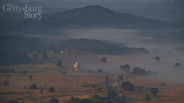 The Gettysburg Battlefield: Cemetery Ridge with the Round Tops beyond.