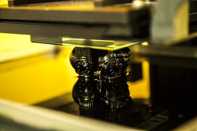 The head coming out of the photo-sensitive material in the 3D printer!