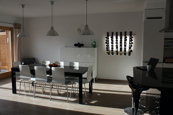 LUMI Wine Wall in a dining room setting.