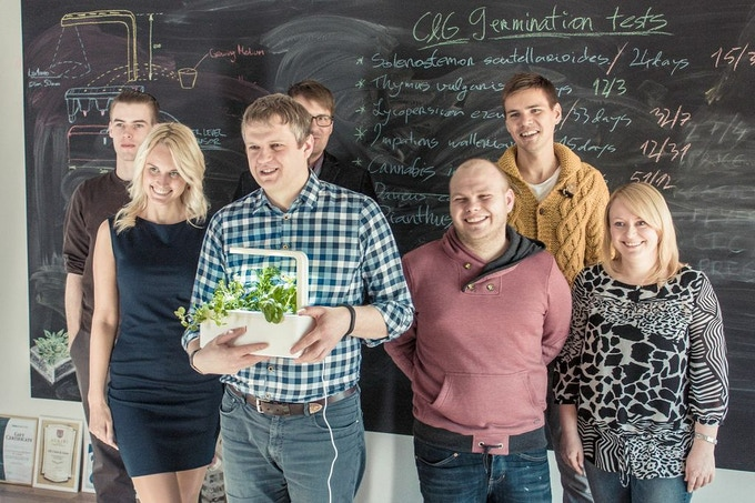 The team. The one holding the Smart Herb Garden prototype is our founder Mattias.