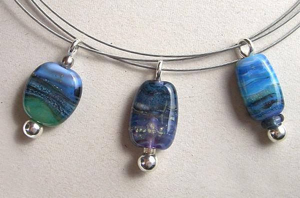 3 necklaces showing Jenefer's 'landscape' design