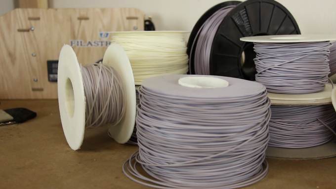 A few of the dozens of spools of filament we've produced so far
