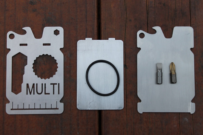 Front Plate, Aluminum Inside Card, Back Plate, (12) O-Rings, Phillips/Flat Head Screwdriver Bits