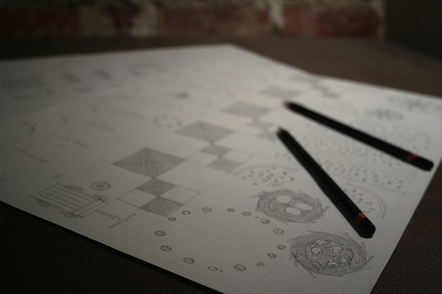Map tiles are meticulously drawn by traditional means, the way they might have done it in ye olde days.