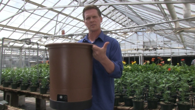 Reb Bieber, inventor/patent holder, shows how portable the Hydropot™ is.