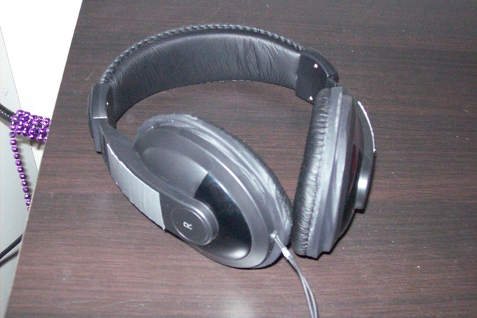 The Yuni, Mark II: Gutted and refitted headphones, with earbuds glued inside.