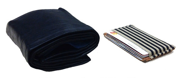 Compare it yourself! The black wallet is an empty regular size wallet!