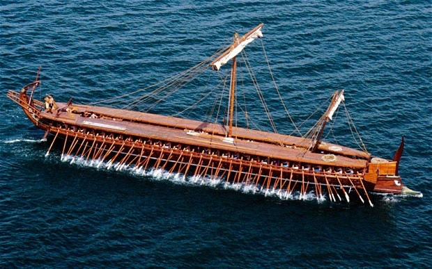 """""""Olympias"""" at sea during its commissioning ceremony in 1987.  It looks even more amazing with its sails up."""