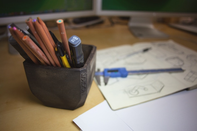not just for flowers and plants, these make handsome holders for desk tools!