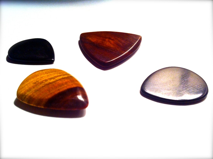 Our most recent batch of Epicks. Featured are two black ebony picks, and two Lignum Vitae.