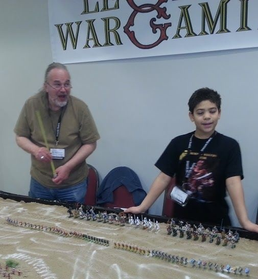 "Michael ""Old Geezer"" Mornard, one of the original players in the Blackmoor and Greyhawk campaigns, introducing my son ""Boboric Jr."" to the joys of Chainmail at GaryCon V"