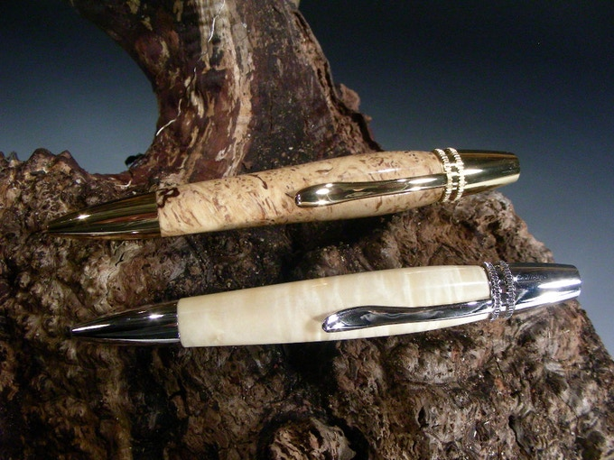 "Polaris Pen shown in Ambrosia Maple Burl with Gold Components and ""White"" Box Elder with Rhodium Components"