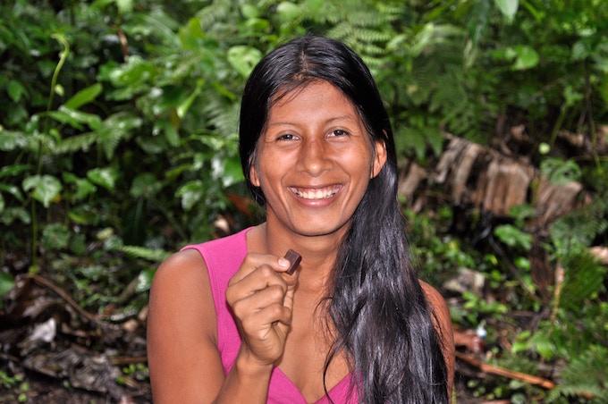 Azucena Tanguila savors a Kallari 70% Cacao bar in Ila Yaku