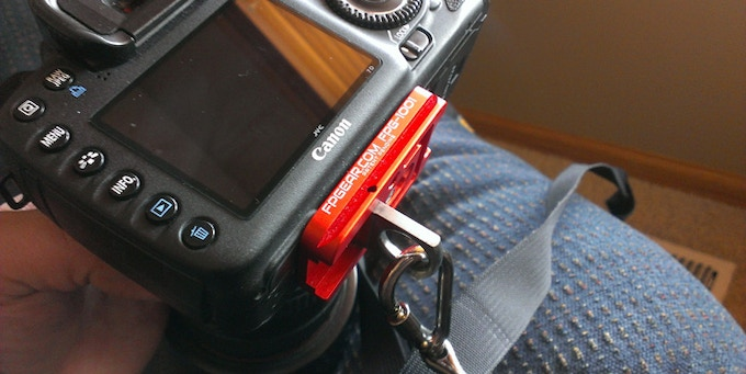 Red Fusion Plate on a Canon 7D with a Black Rapid Strap attached