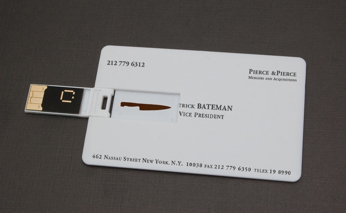 """The 1GB """"Patrick Bateman"""" business card, pre-loaded with """"You Are What You Wear"""" (featured in the video) plus TWO MORE original American Psycho demos by Duncan Sheik + high res iPhone/iPad skins of ALL THREE posters (below)"""