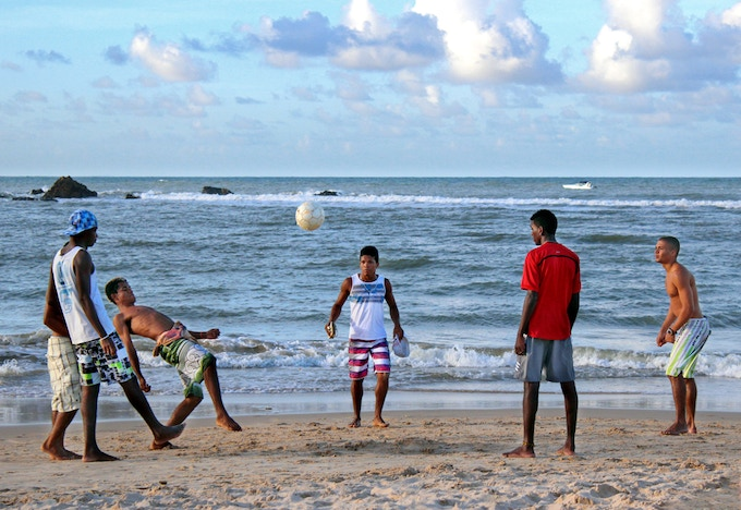 "People on the beach playing ""futevolei"" (soccer/volley) in Morro de Sao Paulo, Brazil"