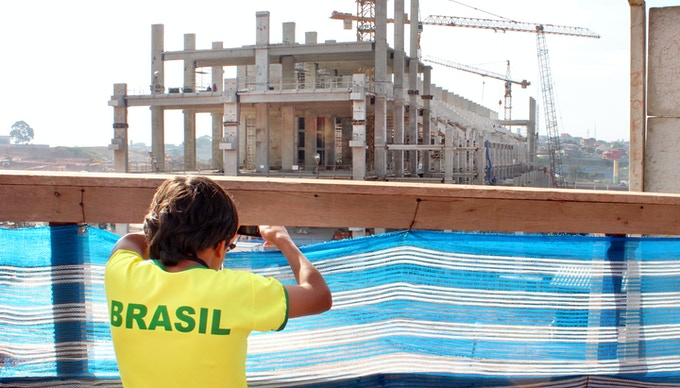 Teenager looking at Sao Paulo's newest stadium, Brazil