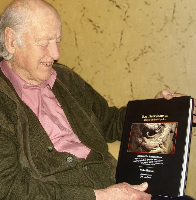 """Ray Harryhausen in his London home with Vol. 2 of """"Master of the Majicks,"""" now out of print."""