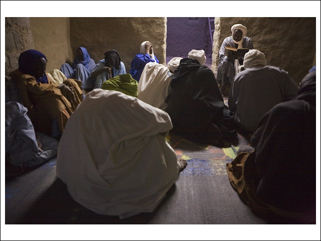 At 5:30am, during the majlis of Shaykh Moulay Ahmed, Hamou (center R) reads the Hadith in Arabic and Imam Sidi Lamine (center L) comments on the text in Songhay, one of the local African languages.