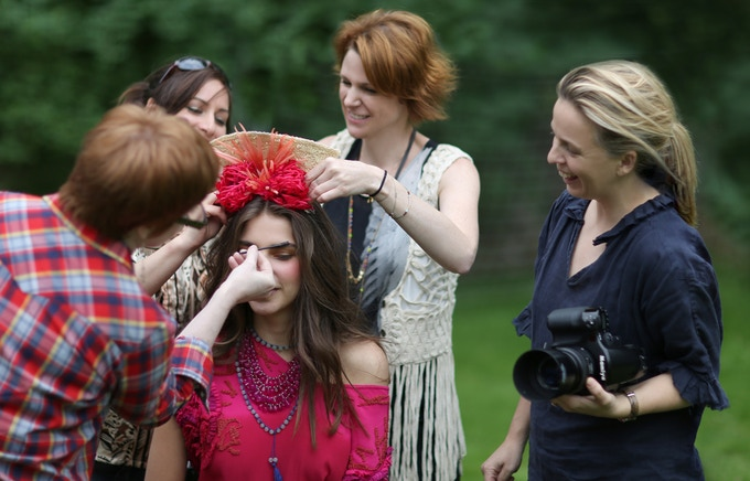 Robyn Lea seen here with with fashion stylist, Bec Cole, and other crew members preparing a shot.