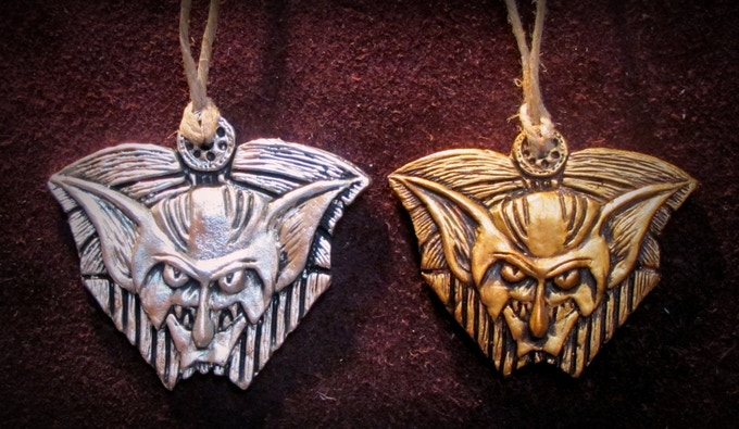 Pewter on the left / Gold painted resin on the right