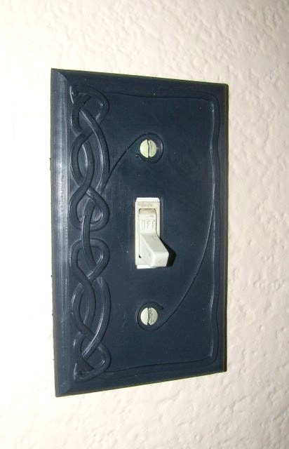 Cover plate for a light switch