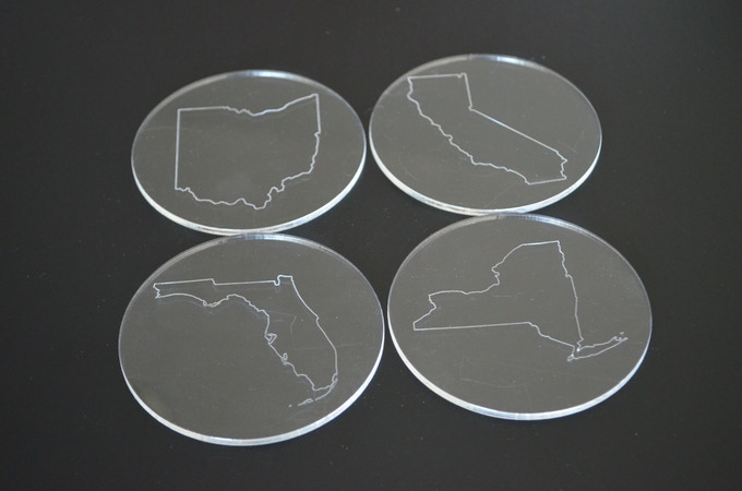 Pick your state out line to be etched on four coasters, laser cut from reclaimed acrylic.