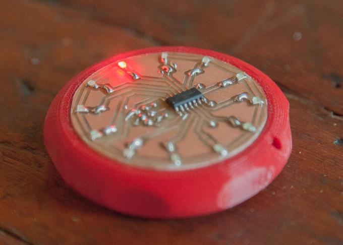 An LED pocket watch made from a custom PCB and a 3D printed body.