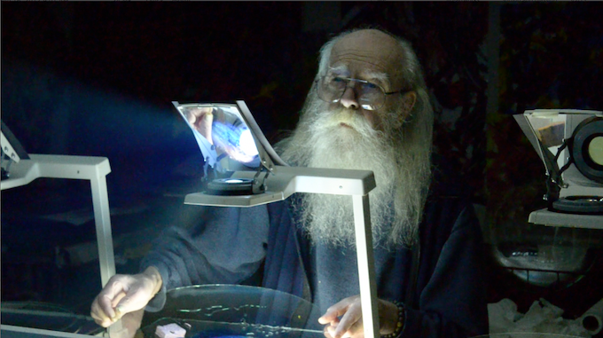 Bill Ham painting with his instrument: the transparent overhead projector (OHP).