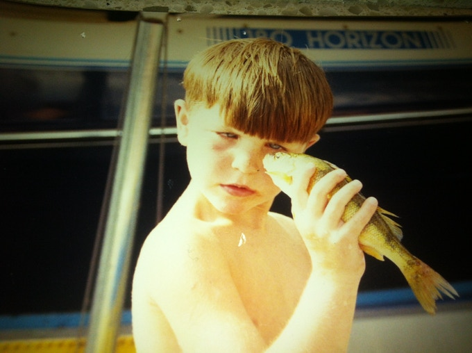 Young Pete Wilson showing his curiosity for fishing.