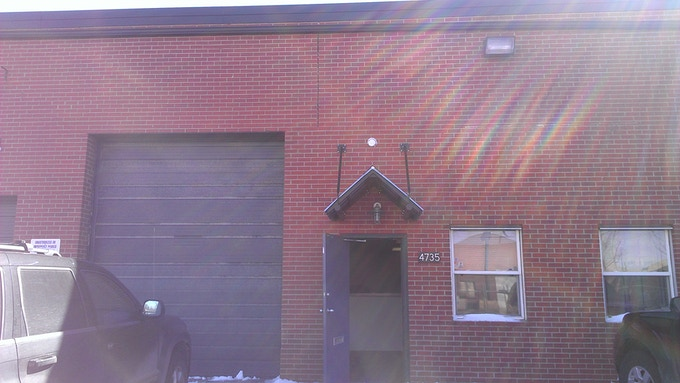 The exterior of Factotum. Step 1 in the beautification process: add glass panels to the garage door.