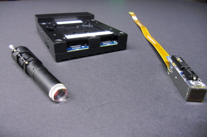 Components of our micro-cameras--- lenses, readout electronics, and sensor