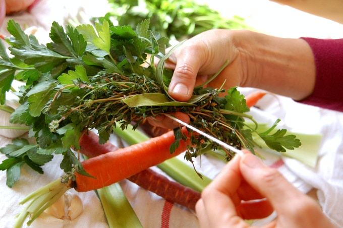 Preparing an herbal bouquet garnier for soup stock