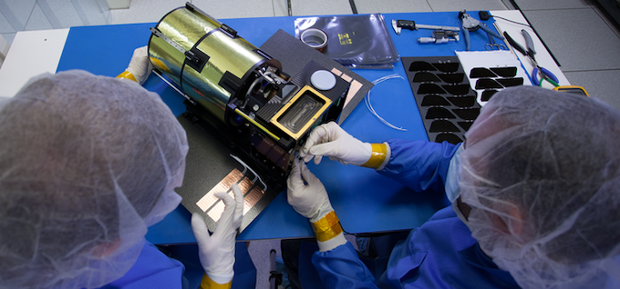 Engineers at Planetary Resources assembling the ARKYD prototype spacecraft.