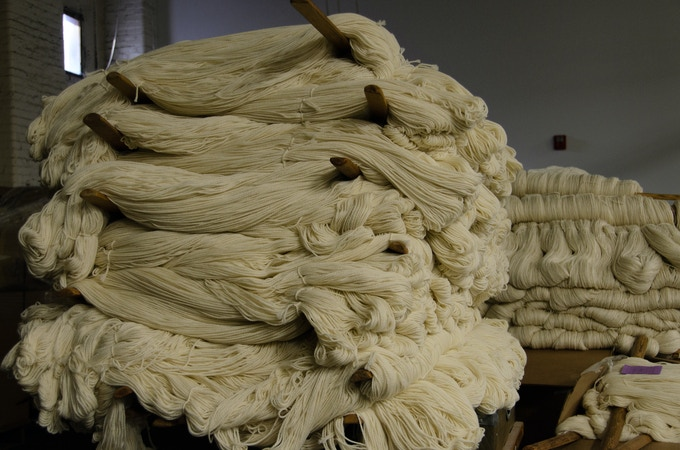 Skeins of wool yarn waiting to go into the Dyehouse - Photography by Peter Hageman