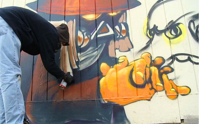 Estria and Katch1 at the Sunday Paint Jam painting an Oakland school.