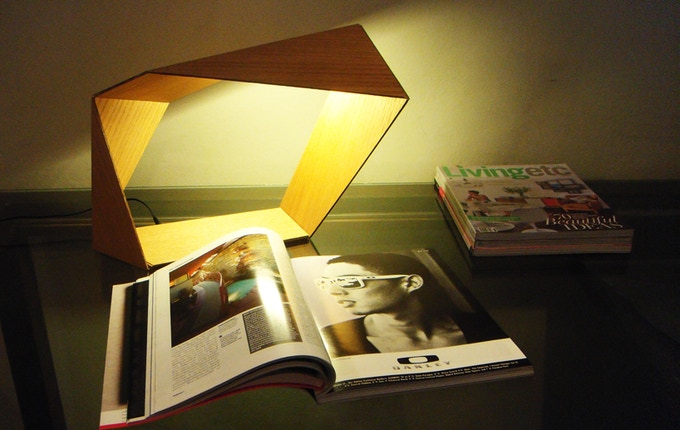 """The """"Loop"""" lamp used as a reading lamp."""