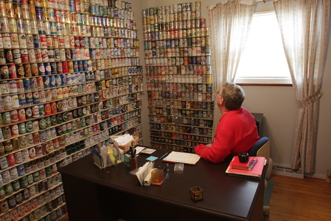 Lance gazing at s small part of his massive beer can collection.