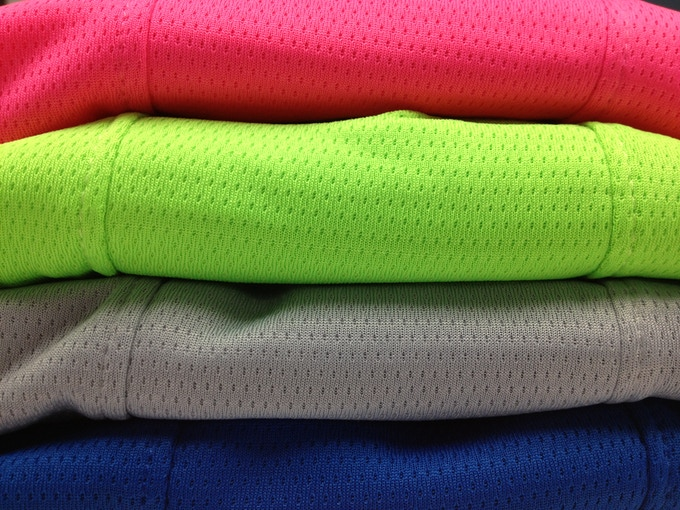 Closeup of Royal, Silver, Lime and Pink RaceMesh Fabric