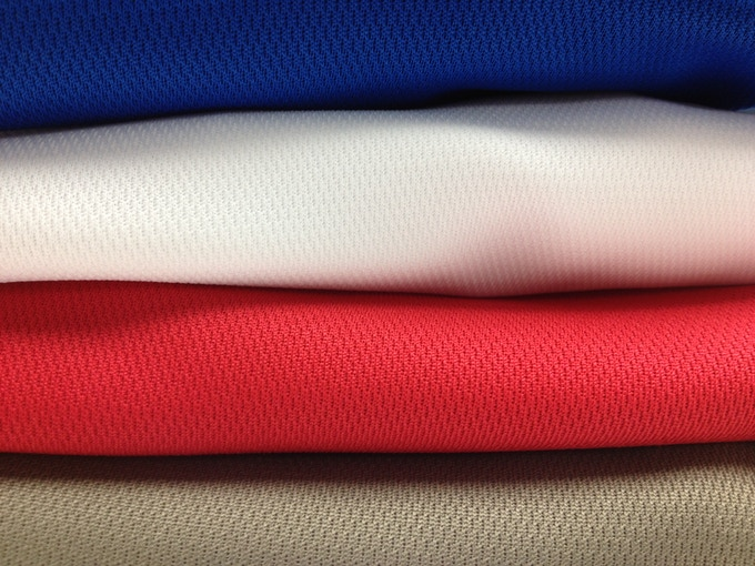 Closeup of Prairie Dust, Red, White and Royal MotionPoly Fabric