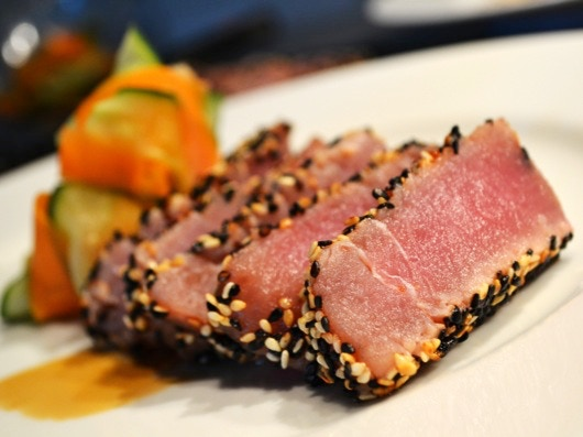 Sesame-Crusted Tuna Teriyaki with Cucumber & Carrot Relish, cooked to a velvety rare.
