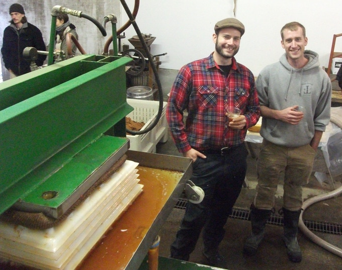 Abram and brother Eli Goldman-Armstrong pressing cider in 2012