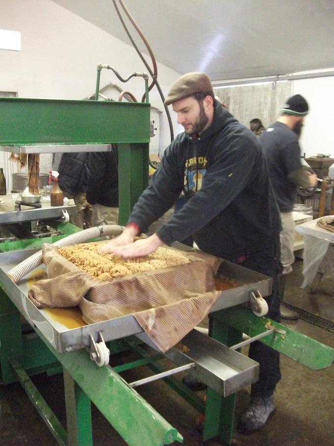 Abram Goldman-Armstrong pressing cider in 2012