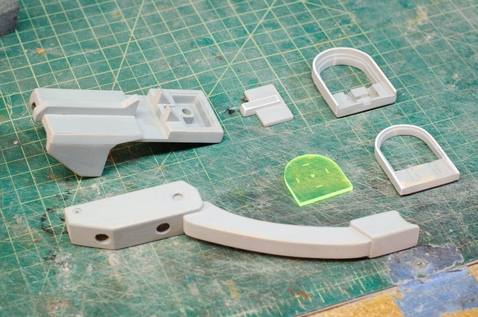 The scope and hand guard accessory prototypes.