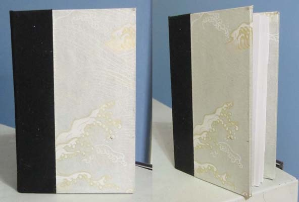 Hand-made sketchbook, 4.25 x 2.75 in. **Book covers may vary**