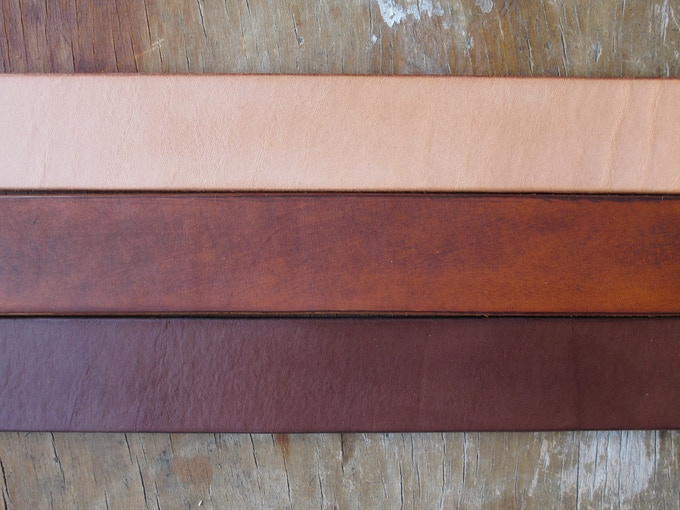 There are three color options for leather rewards (from top to bottom): natural, timber and brown.  All of the goods in the photos above were either natural or timber.