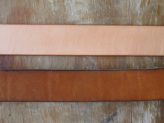 All natural leather products patina as they age. Most will pick up a golden russet color as pictured above, but every item will uniquely vary.  Above — natural leather as new.  Below — a natural belt with a years worth of patina.
